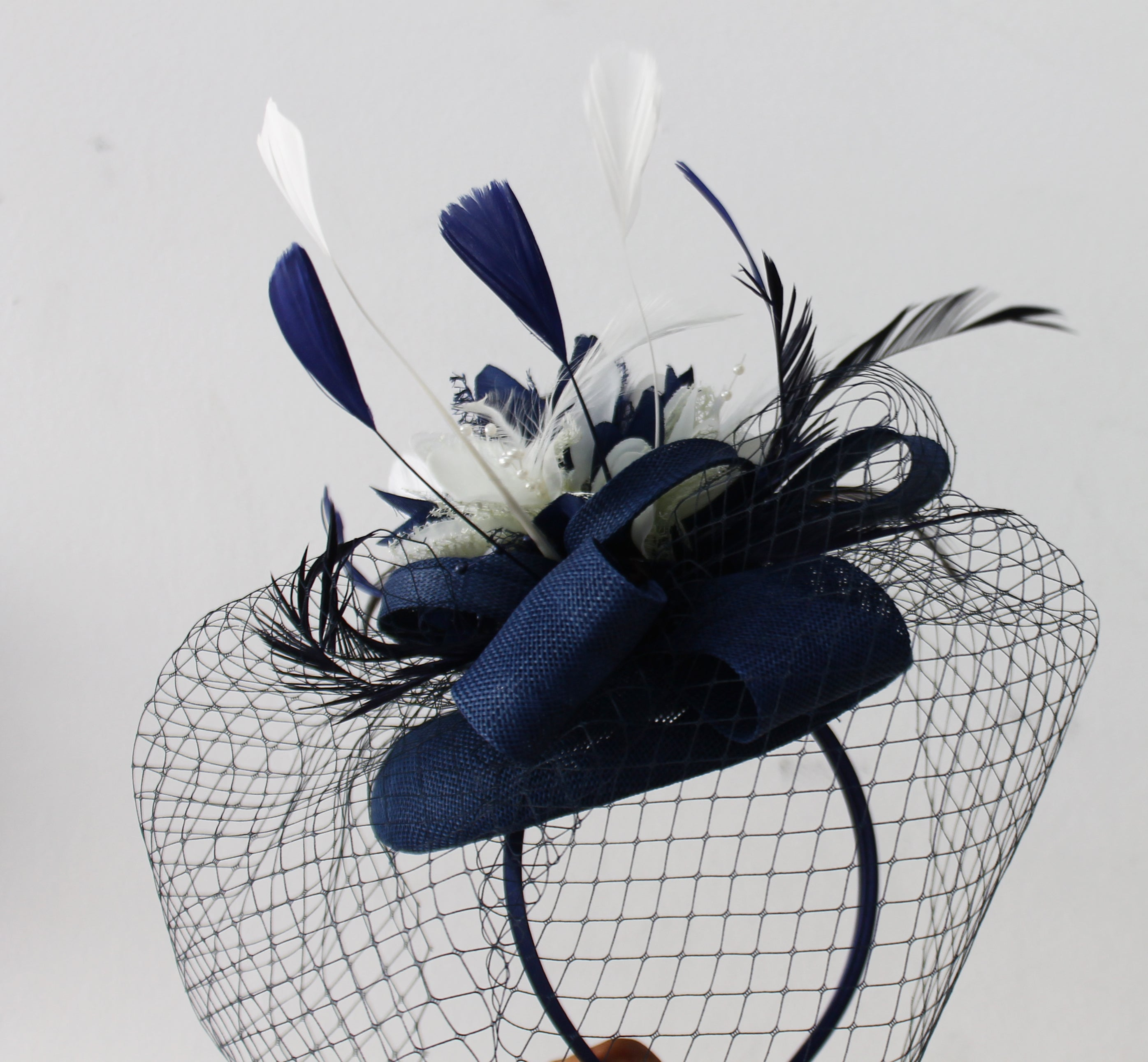 Navy and Ivory Pillbox Fascinator with birdcage veil and flower feathers