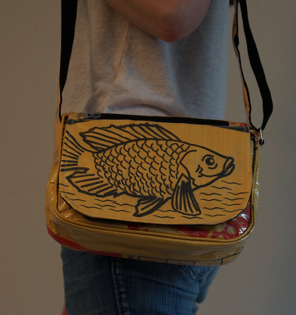Recycled / Upcycled Ladies Handbag. Handmade in Cambodia from recycled fish feed sacks. Yellow Fish Design