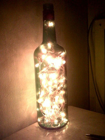A bottle lamp made with a wine bottles and LED fairy lights
