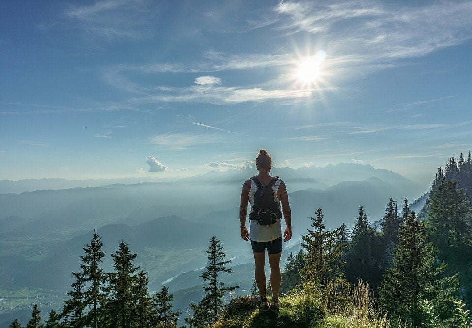 A woman hiking with a backpack