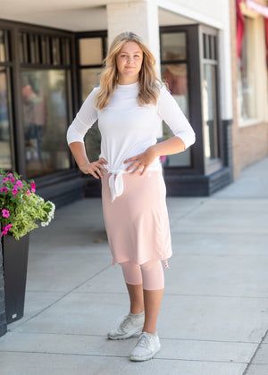 Modest women in a sport skirt and sweat wicking tee