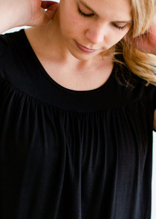 Inherit Co.  | Feminine Drape Top-FINAL SALE | Woman wearing a modest black top with a denim jean skirt