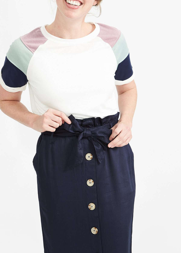Inherit Co.  | Button Up Paper Bag Midi Skirt-FINAL SALE | Woman wearing a navy button front paper bag style midi skirt.