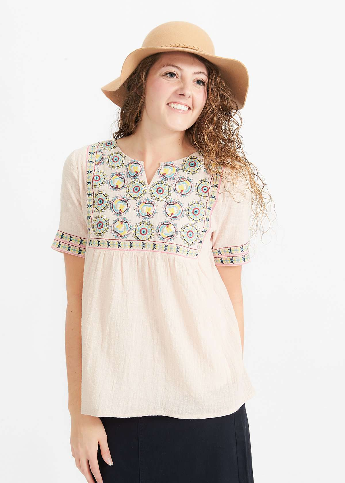 Woman wearing a blush embroidered bohemian style top