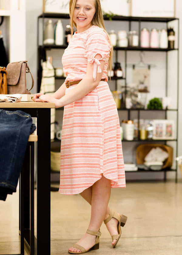 pink and white striped midi dress at inherit clothing company