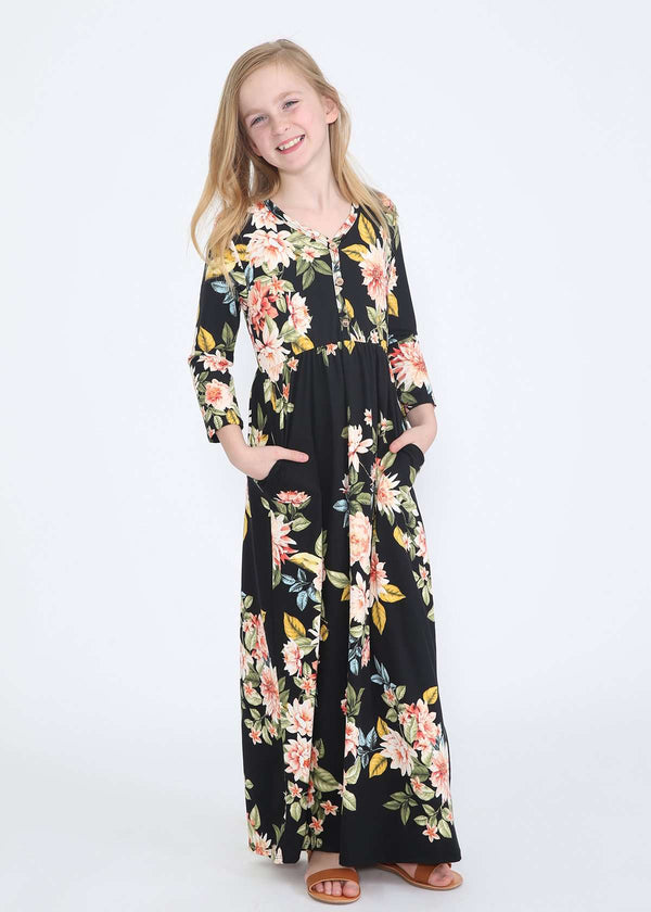 e16bfeb1d0fee young girl wearing a modest black maxi dress with flowers on it