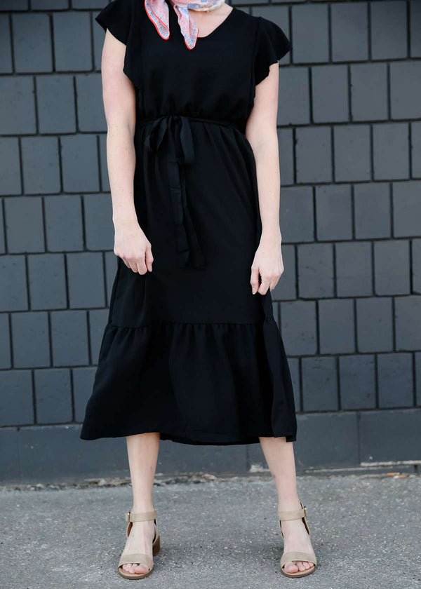 Modest women's black ruffled midi dress