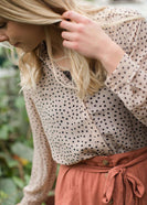 polyester sheer taupe top with black polka dots