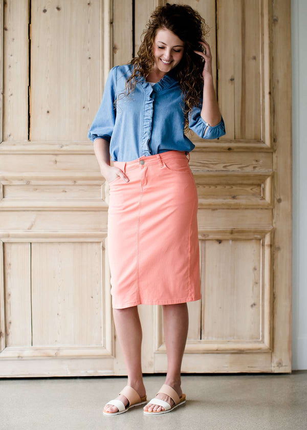 modest coral colored denim midi skirt
