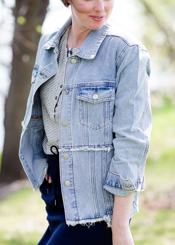 women's modest light denim distressed jean jacket