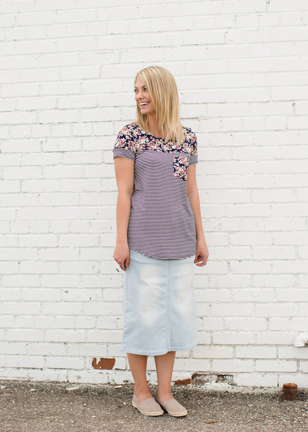 Inherit Co.  | Modest Women's Skirts | Kara Midi Skirt | Young lady wearing a light denim below the knee jean skirt.