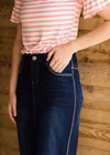 Dark blue denim midi skirt with detailed seem stitching and pocket stitching
