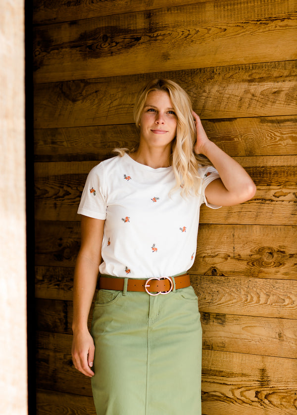 Women's ivory tee with orange and green embroidered accents