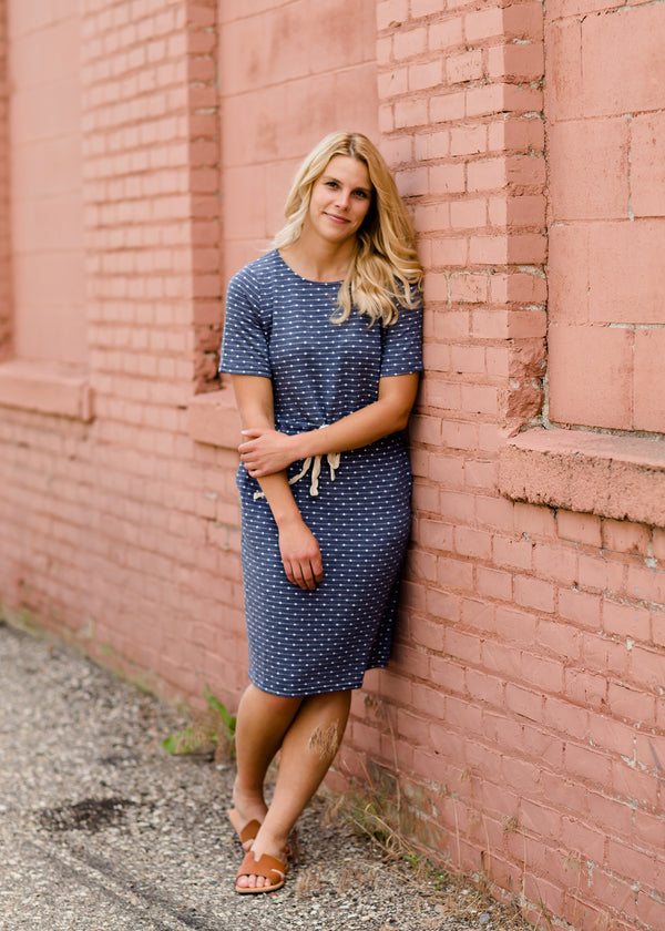 Navy dot knit midi dress with pockets and an adjustable waist