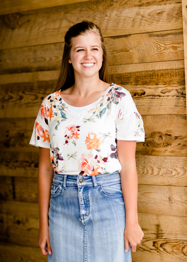 Modest cream tee with multi-colored floral detail