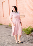 Shop this modest women's midi dress in purple, mint, gray and pink!