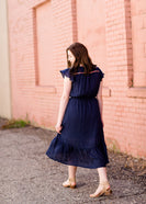 Navy midi dress with colorful embroidered accents