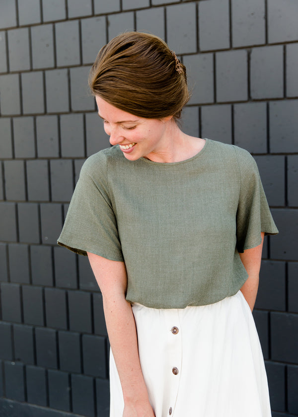 Olive blouse with a button detail