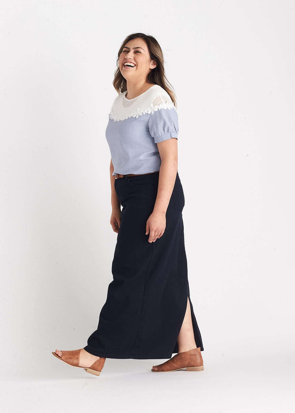 Inherit Co.  | Modest Women's Skirts | Stella Navy Long Denim Skirt | woman wearing a long navy colored modest denim skirt