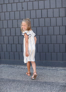 Ivory girls dress with mustard and navy stripes and lace flutter sleeve detail
