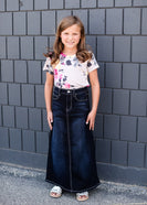 little girl wearing a dark denim jean skirt with no slit and  pocket stitching