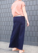 woman wearing a long aline no slit denim skirt