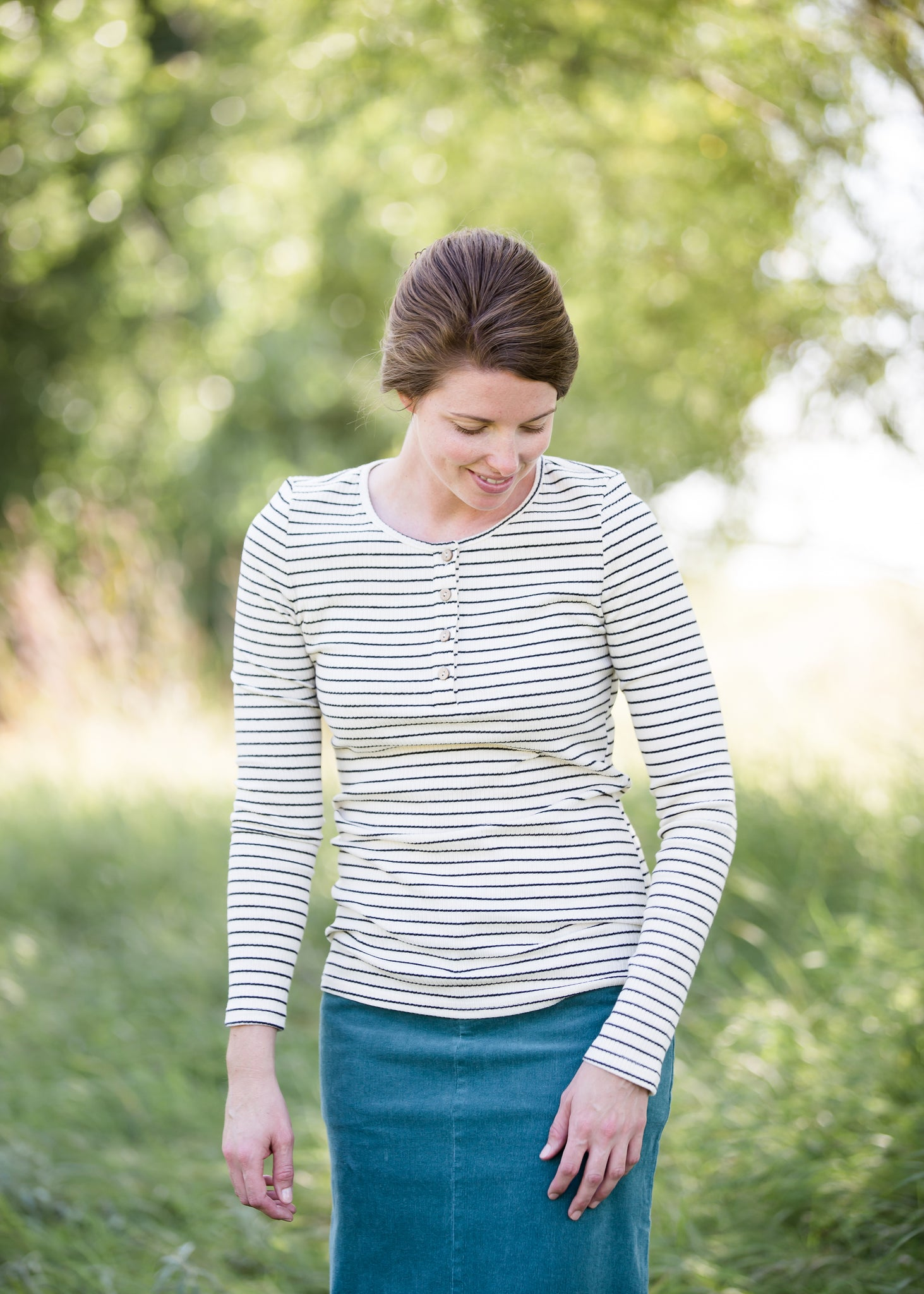 woman wearing a black and white striped henley top
