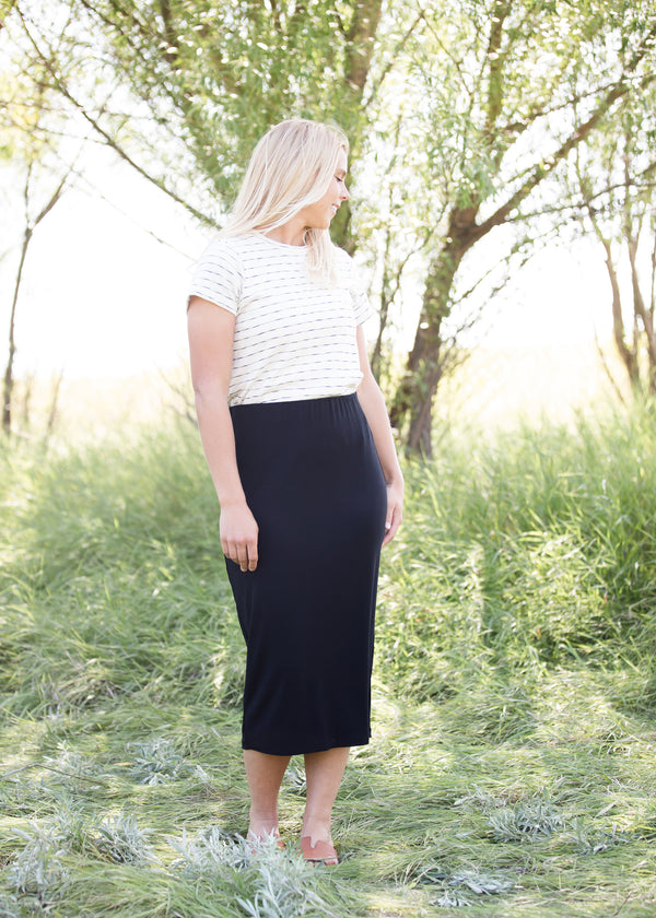 Inherit Co.  | Modest Plus Size Clothing | Kate Midi Skirt | Woman wearing a straight style, ultra soft versatile black midi skirt.