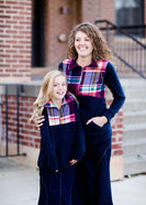This half zip pullover features a front pouch pocket and a beautiful color block print of fuchsia, teal and mustard! It also is a mommy and me style.