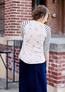 Woman wearing a modest baseball tee with black striped arms and a blush floral body along with her daughter making it a mommy and me modest raglan style tee shirt
