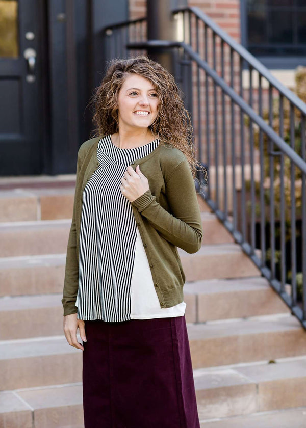 Inherit Co.  | Modest Women's Tops | Essential Crewneck Cardi | Woman wearing a modest and classic pink, burgandy, emerald and olive colored button up crewneck cardigan with a midi skirt