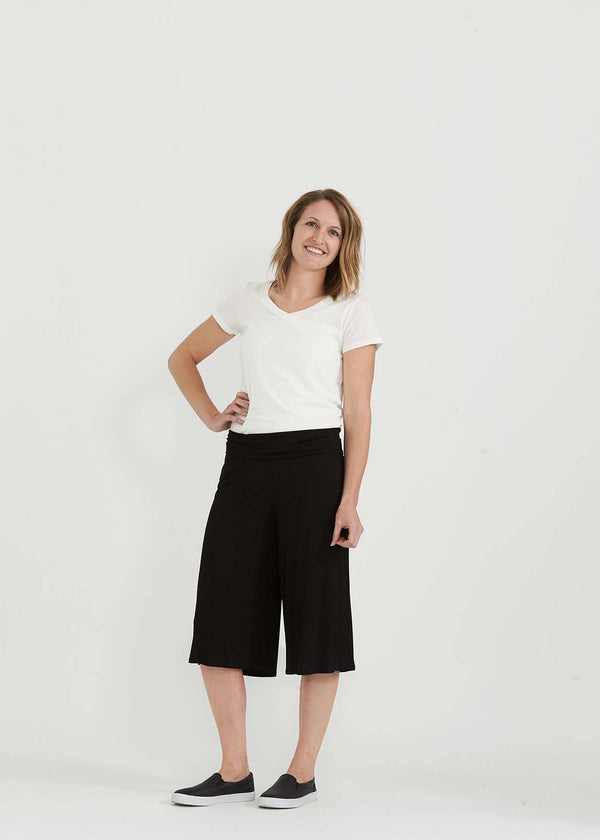 Inherit Co.  | Gaucho Midi Split Skirt | woman wearing black stretchy gauchos