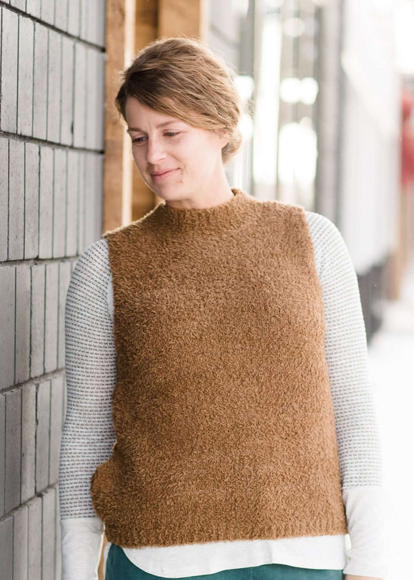 Inherit Co.  | Modest Women's Tops | Mock Neck Sweater Vest - FINAL SALE | Woman wearing a tan colored fuzzy sweater vest. This vest has open sides and a ribbed bottom. It is also paired with a teal colored below the knee corduroy skirt.