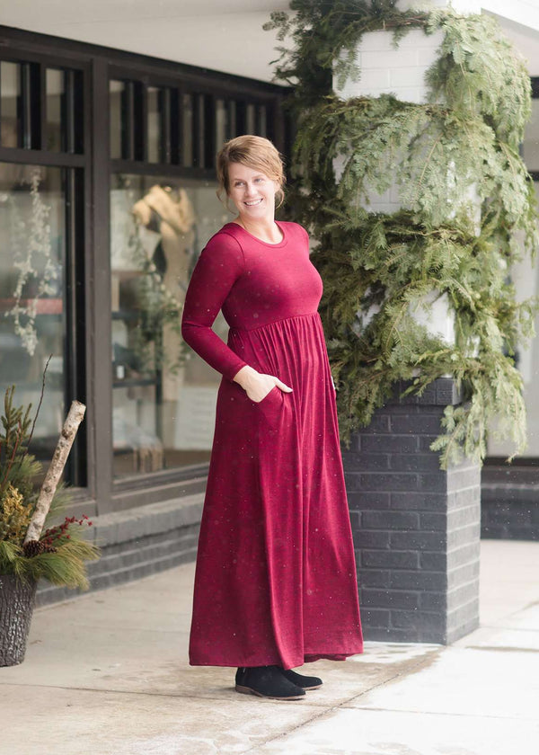 Inherit Co.  | Women's Modest Dresses | High Waist Solid Maxi Dress | Woman wearing a wine colored maxi dress made of a hacci material standing outside of Inherit Clothing Company