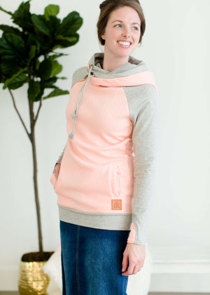 Ampersand Doublehood Hooded sweatshirt with peach quilted body and gray contrast sleeves.