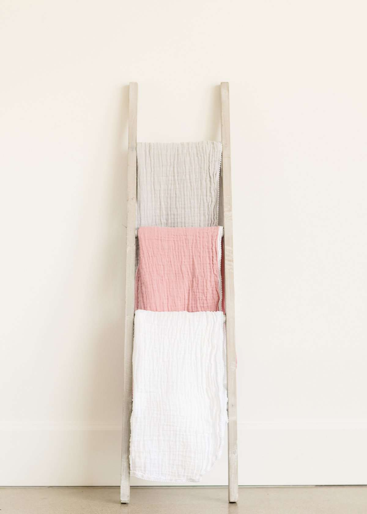 100% Cotton muslin swaddle blanket in gray, mauve or white