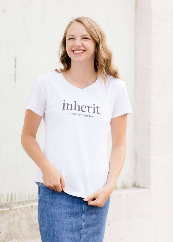 Inherit Co.  | Modest Women's Tops | Inherit Logo Tee | White modest v-neck t-shirt with inherit logo across the chest.