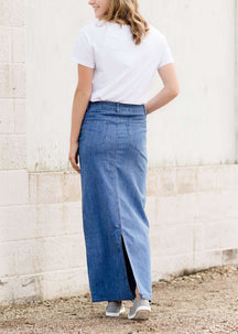 Woman wearing a long denim modest jean skirt