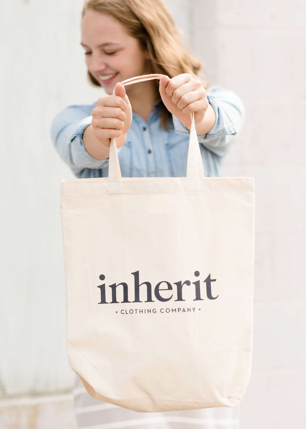 Cream cotton canvas tote with Inherit logo.