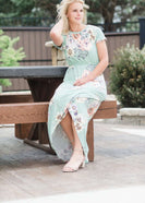 maxi length floral dress with elastic waist that comes in blush, mint or navy florals.