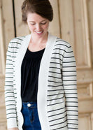 woman wearing a black and white striped open front cardigan
