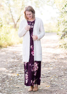 Women's cozy long vanilla cardigan with clasp close front and two side pockets.