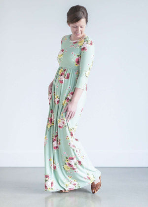woman wearing a modest mint and floral maxi dress