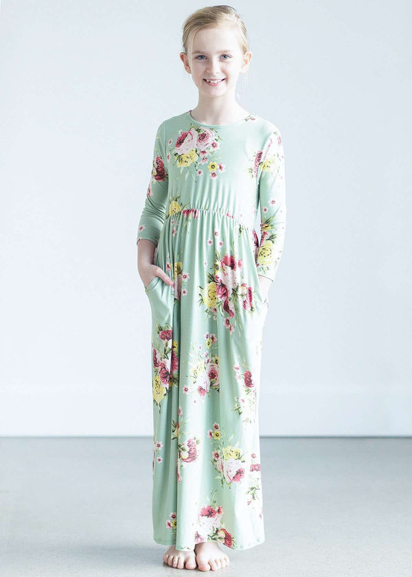 2c0fba5c9d299 young girl wearing a modest mint and floral maxi dress