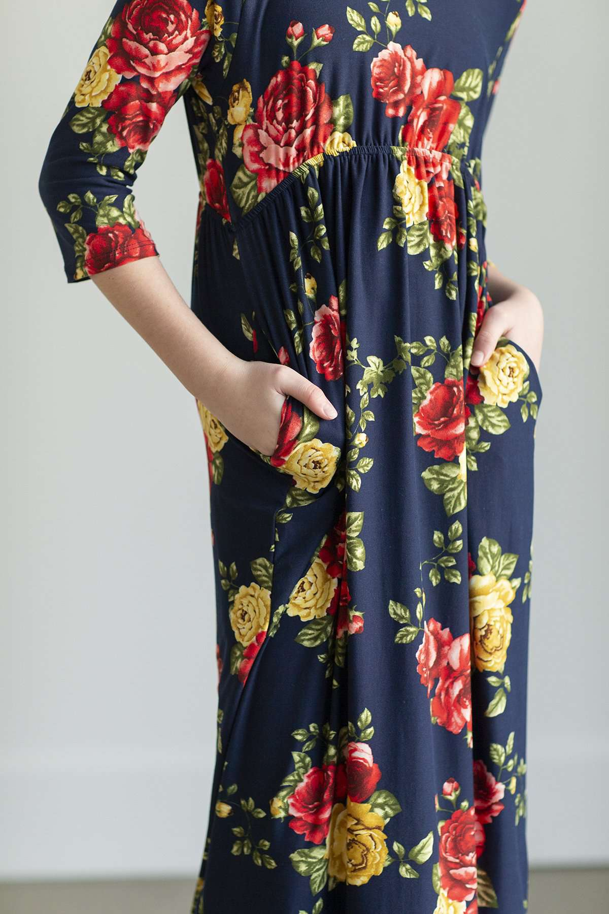 Young girl wearing a navy floral maxi dress