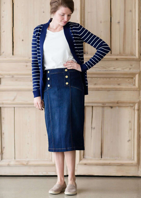 woman wearing a modest below the knee button accent denim jean skirt with no slit