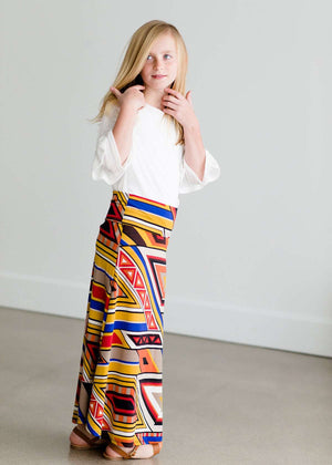 Girl wearing a modest maxi dress that is multi color and stretchy