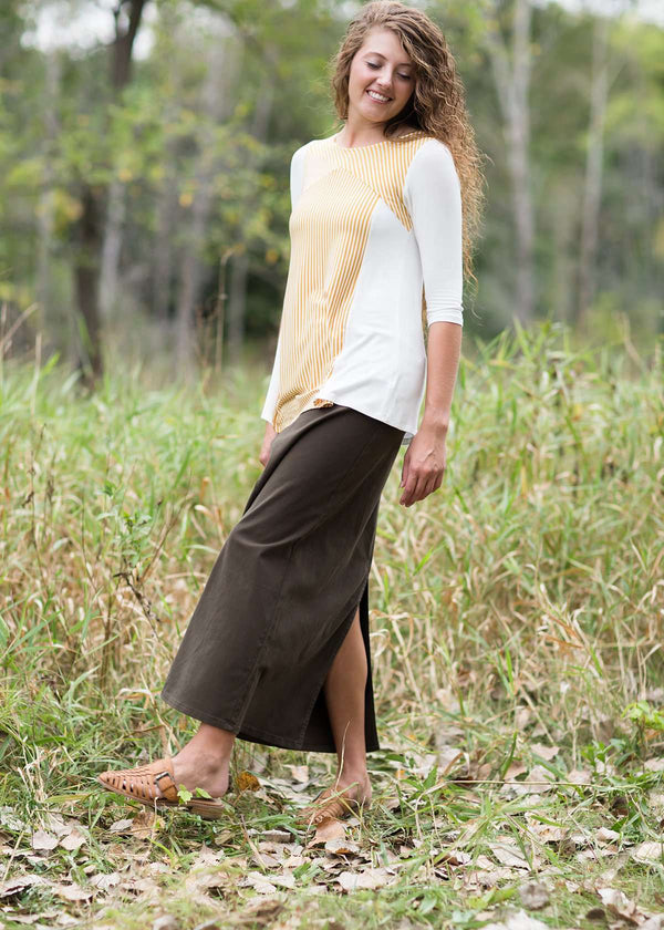 woman wearing a long olive colored modest denim skirt