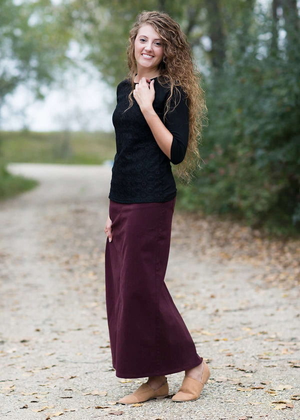 Inherit Co.  | Inherit Exclusives | Stella Wine Long Denim Skirt | woman wearing a long burgandy colored modest denim skirt