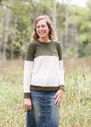 oatmeal colored sweater with olive stripe block top and front pocket.